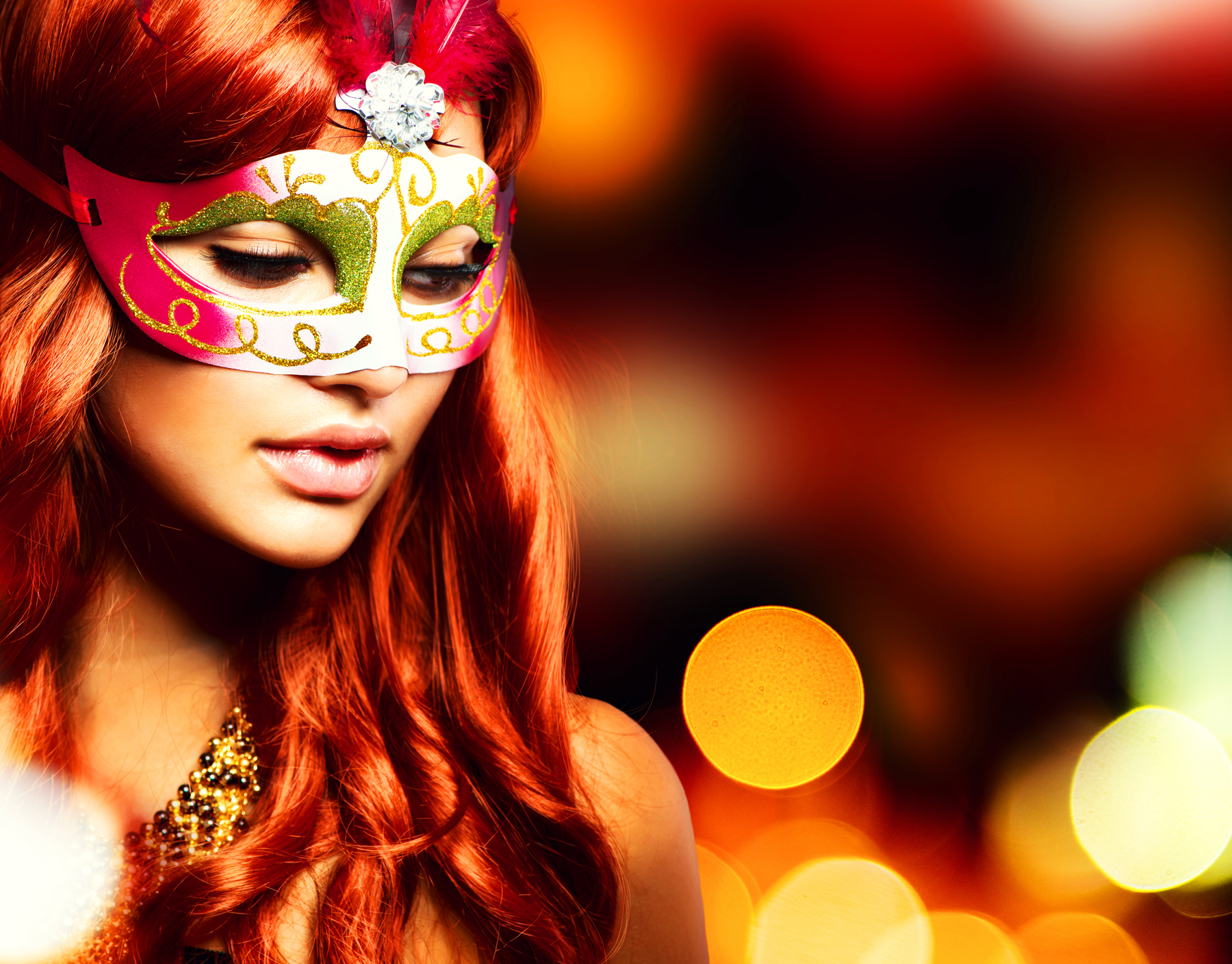 Party.Masquerade. Beautiful Girl in a Carnival mask over Holiday